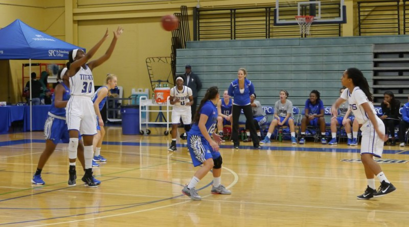 Myia Fletcher (#5) passing to Shaquoria Miles (#30).