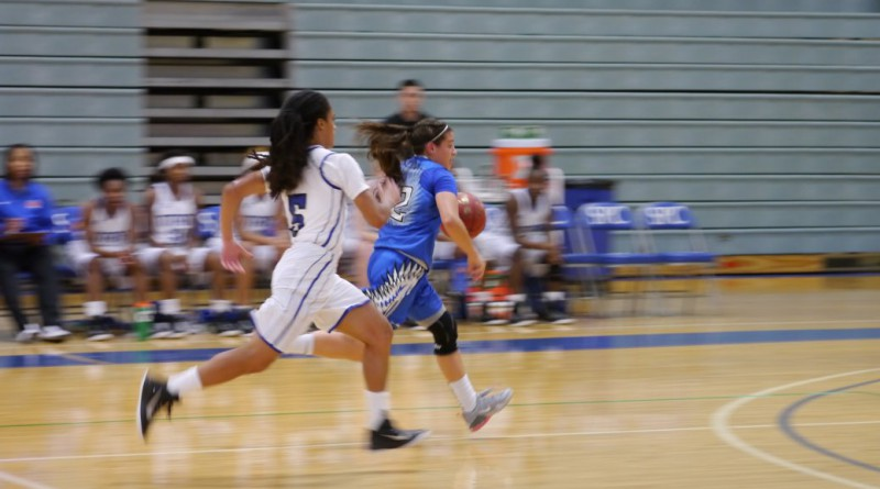 Myia Fletcher (#5) pursues a Seahawk down court.
