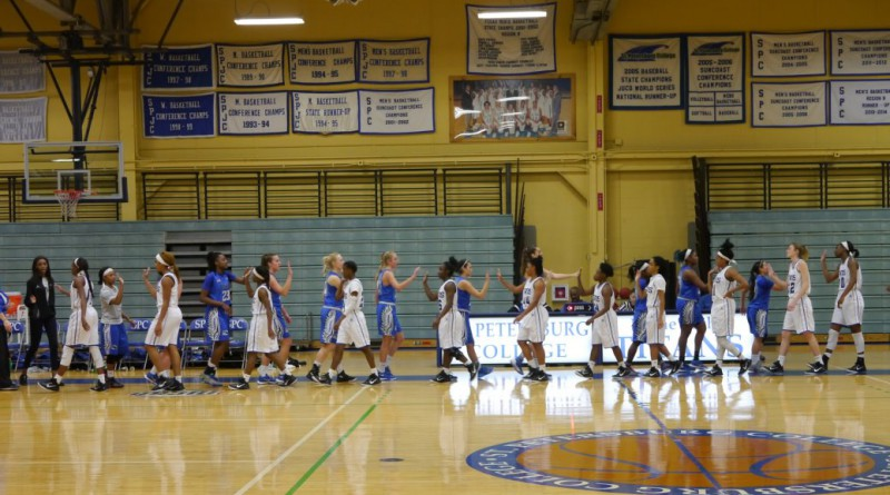 Lady Titans and Broward College Seahawks at the end of the game.