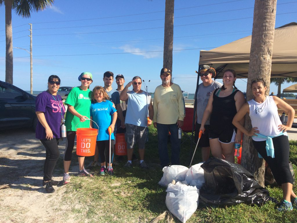 SPC group photo with trash collected. The event was organized by Christina Kugeares, SPC math tutor and Wildlife Rehab Specialist, on the right.
